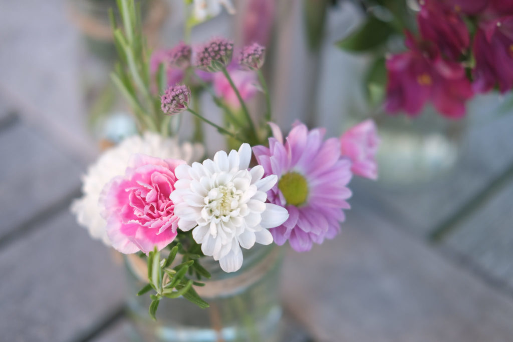 Flower table decorations at summer garden party in Bath