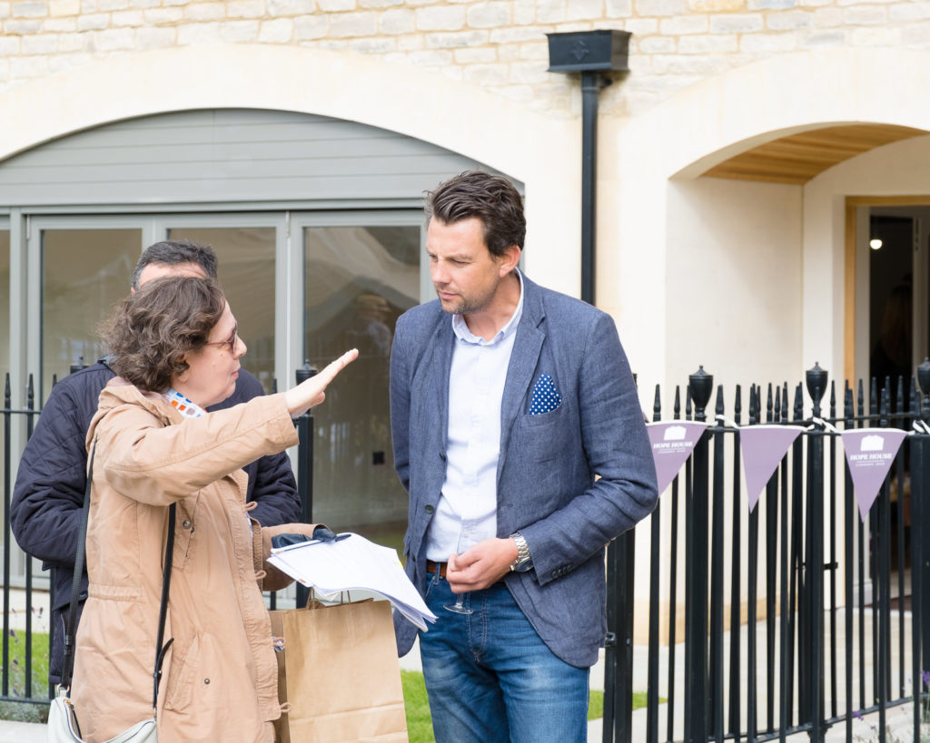Sales team discussing details with potential buyers at property launch