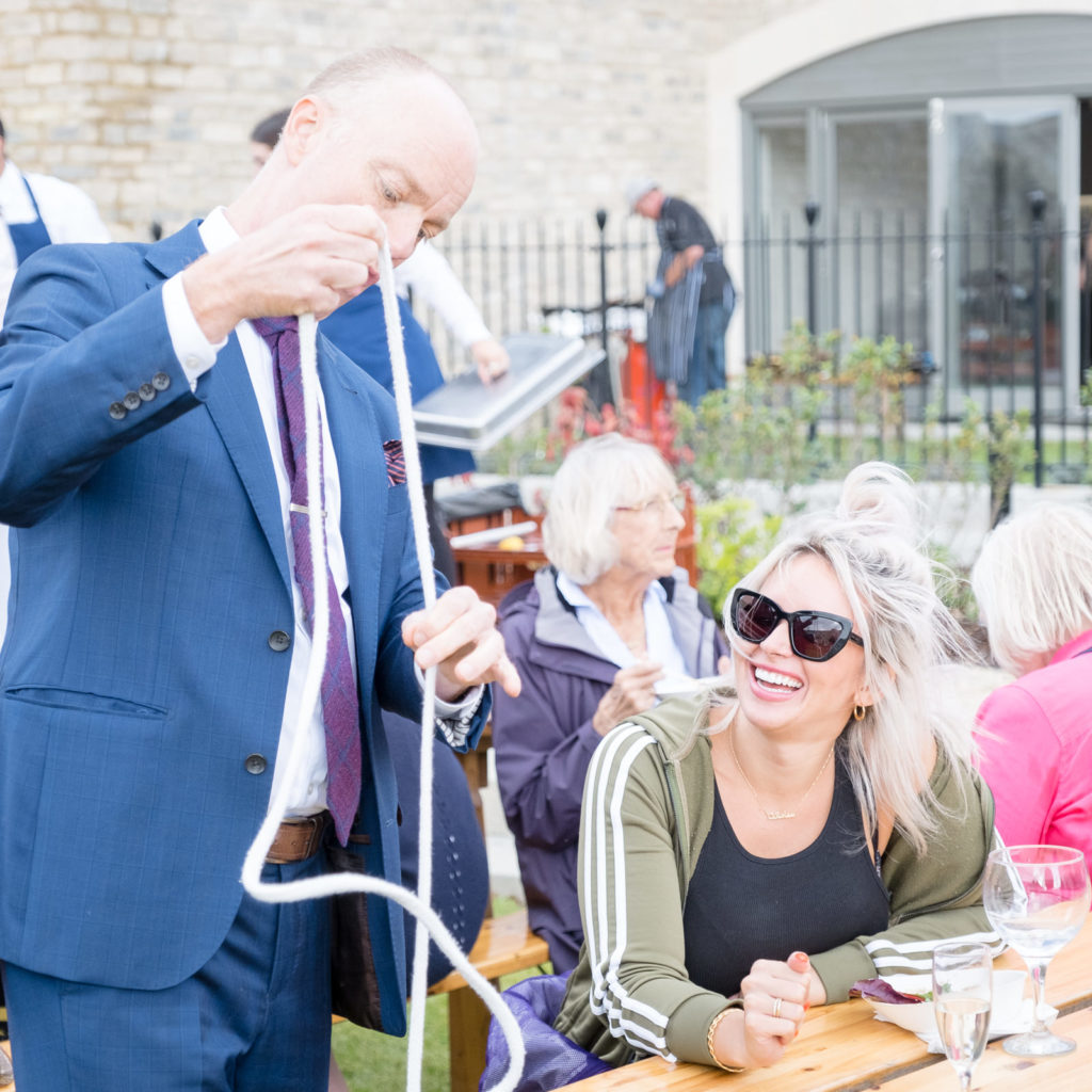 Magician entertaining guests at property launch in Bath
