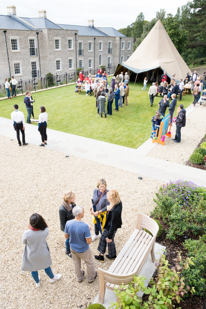 Guests enjoying drinks and entertainment at property launch in Bath