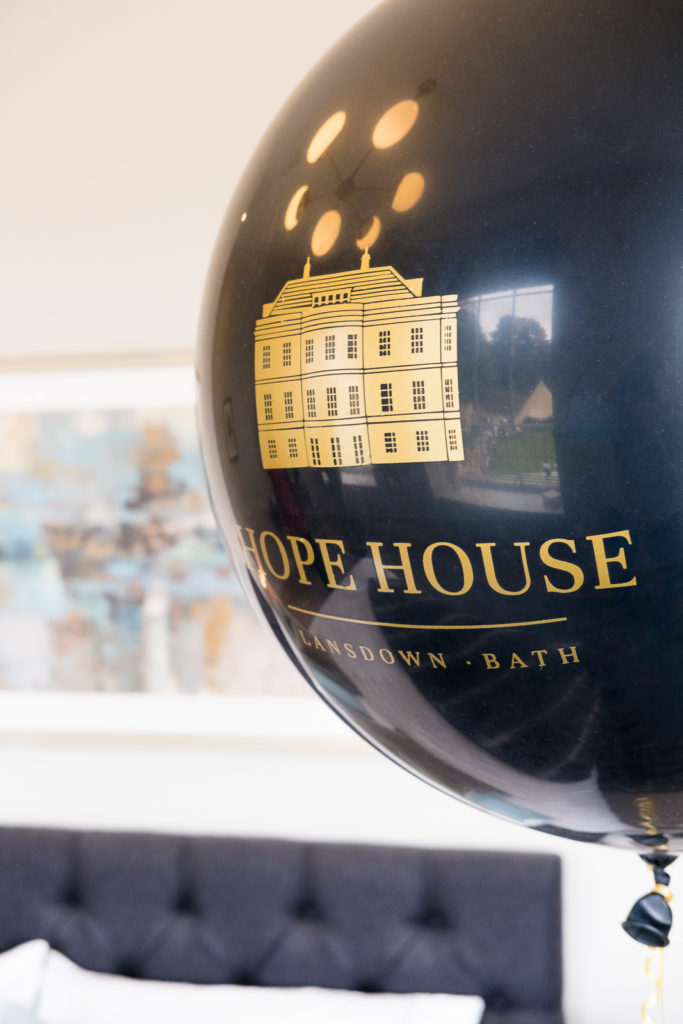 Branded black and gold ballon at a property launch in Bath