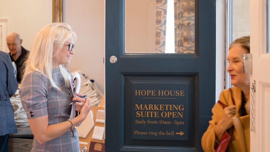Sales team welcoming a guest at a property launch in Bath