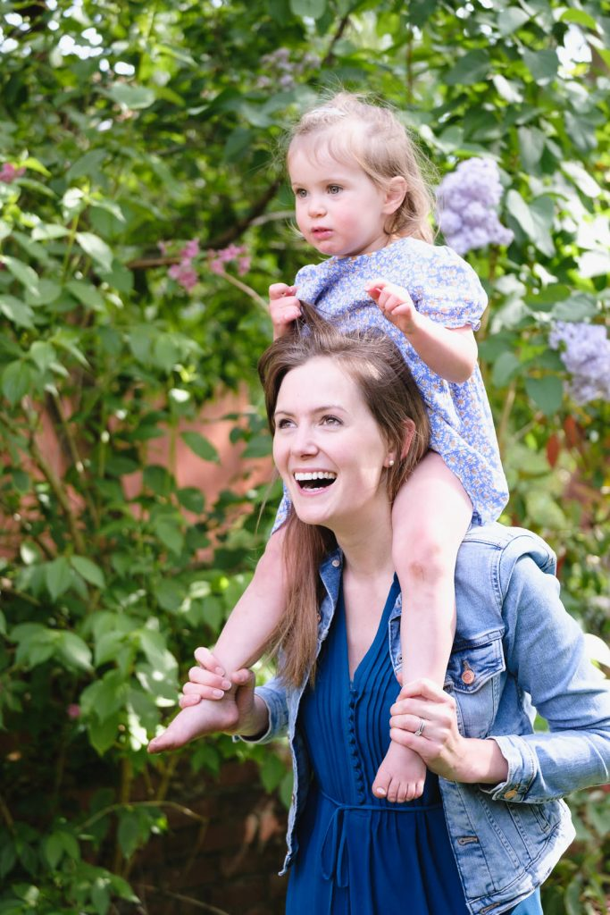 Mum and young daughter playing in their summer garden