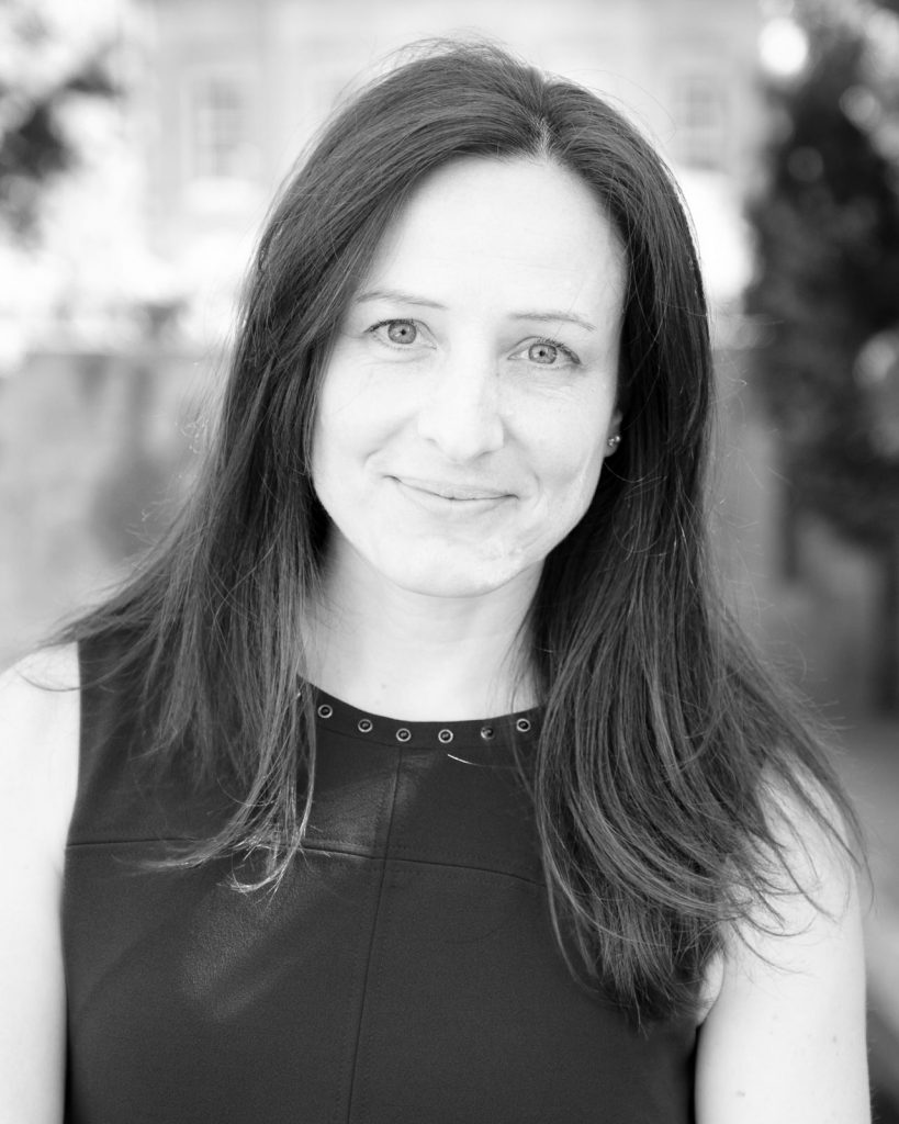 Headshot of female business owner in black & white