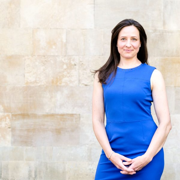 Confident business woman in bright blue dress