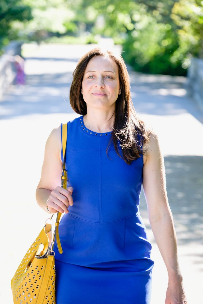 Personal branding photo of female business owner walking through the park