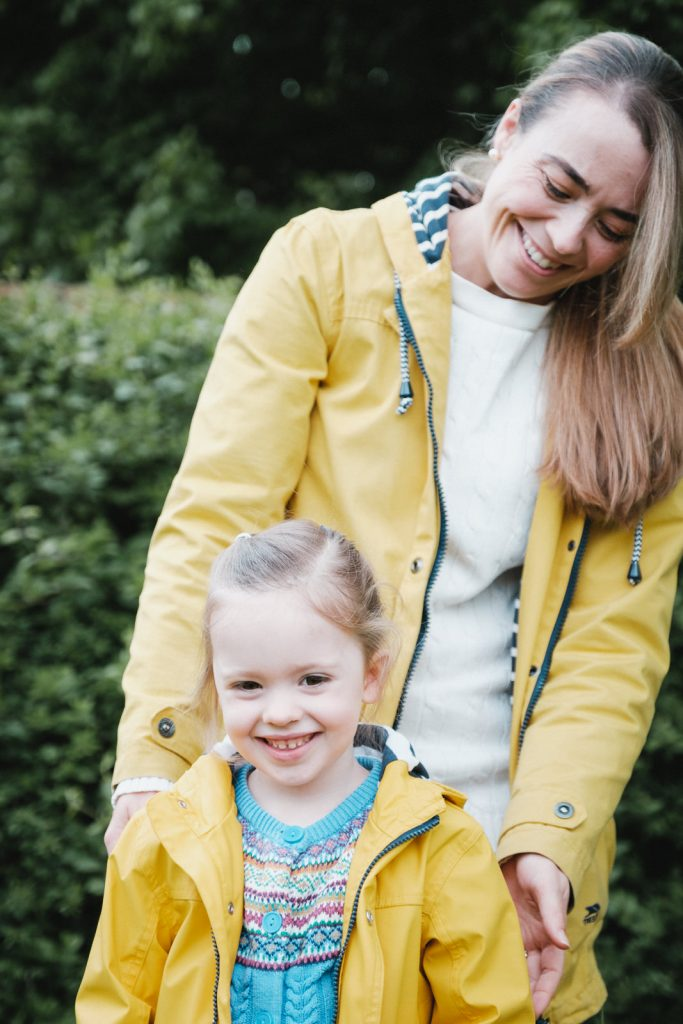 Mother and daughter in bright yellow rain coats