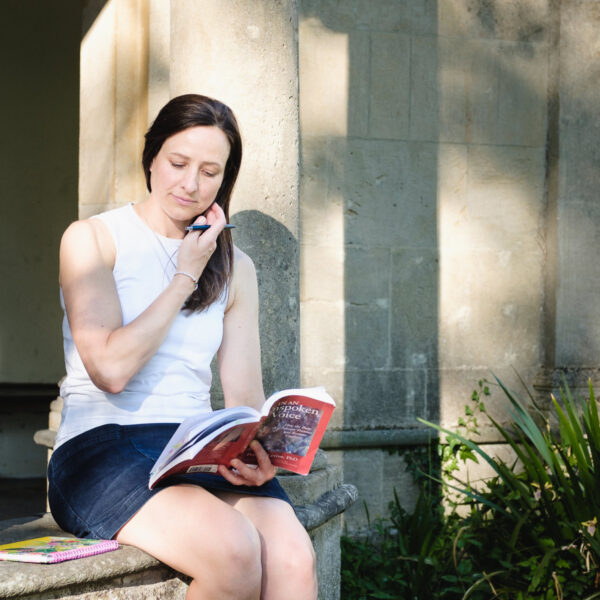 Business owner reading a book out doors