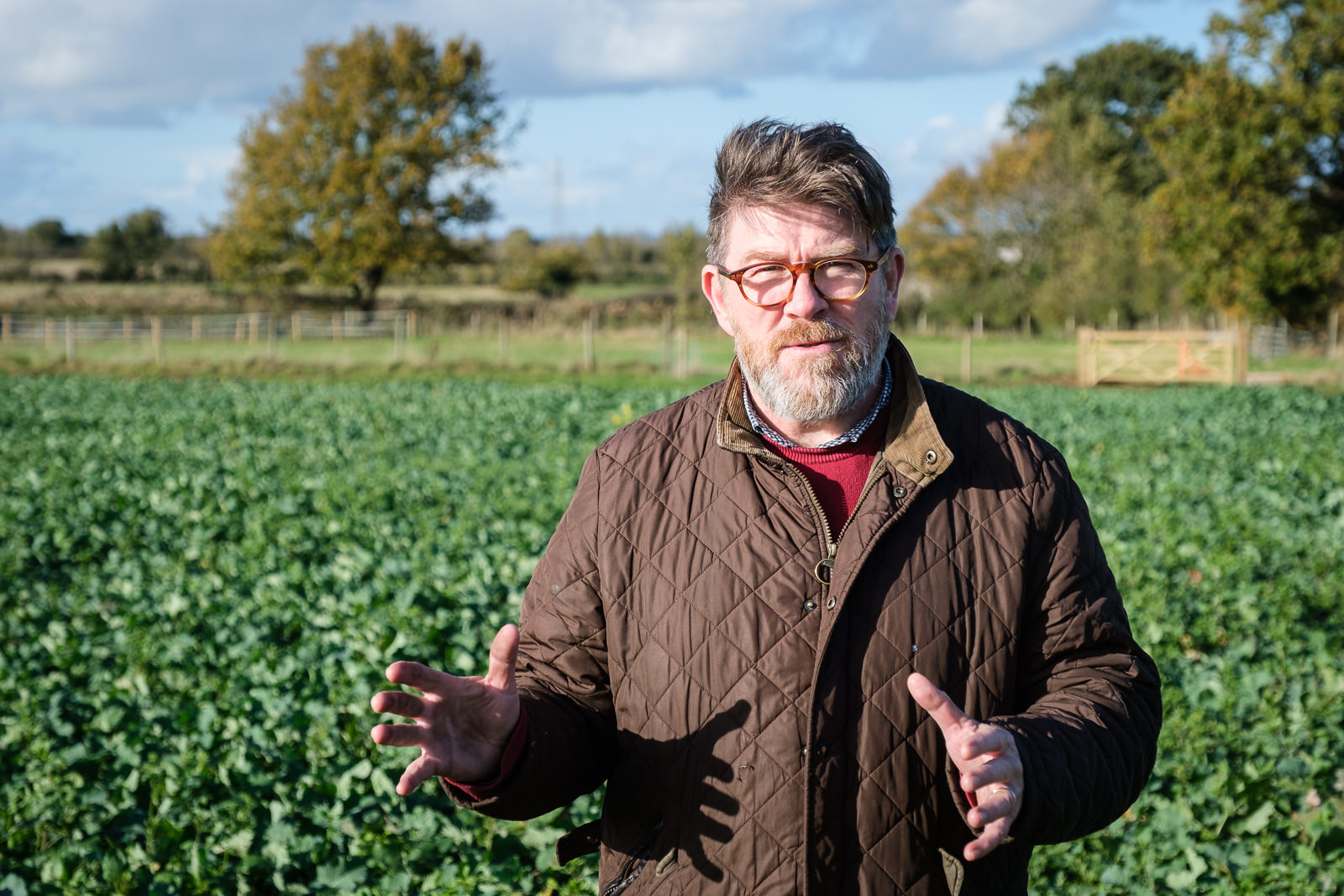 Portrait of Tim Fussell in a rapeseed field in rural Wiltshire