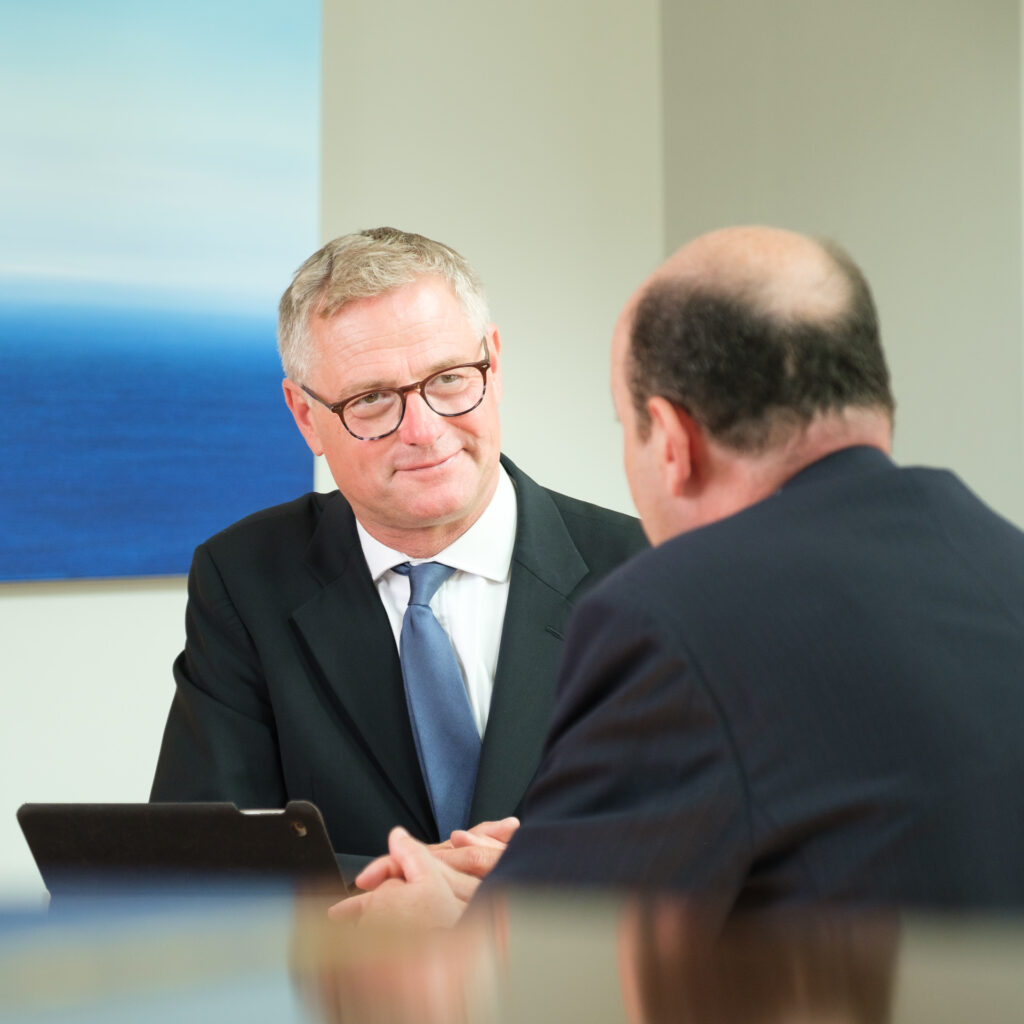 Legal professional in conversation with a client by Nick Cole Photography