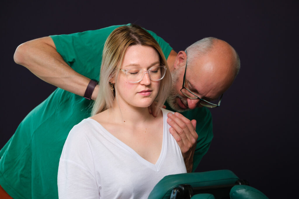 Young woman having a neck massage by Bristol based massage therapist - Photography by Nick Cole Photography
