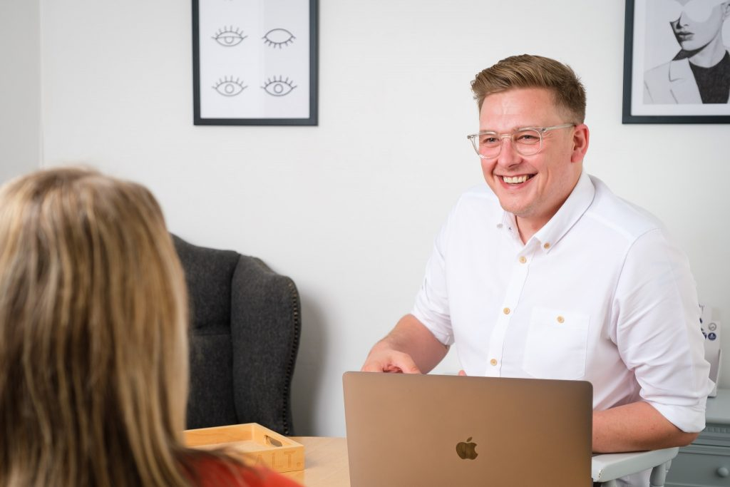 Business photography independent opticians client consultation